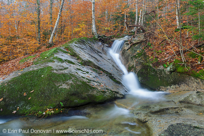 Clough Mine Brook, a tributary of Lost River, in Kinsman Notch in North Woodstock, New Hampshire during the autumn months. Kinsman Notch is located in the White Mountains between Mount Moosilauke and the Kinsman Range. Lost River drains to the southeast and the Wild Ammonoosuc River drains to the northwest.