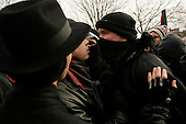 WASHINGTON DC - JANUARY 20: Anti-Bush/war protesters in Malcolm X park before marching to the parade route January 20, 2005 in Washington DC. Pro-Bush and anti-Bush demonstrators face off and throw a few punches at each other.(photo by Anthony Suau)