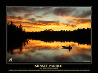 """This is a 18"""" x 24"""" commemorative poster design that features Dawn's stunning photograph, """"Sunset Paddle"""",  which is part of the special Wilderness Forever Exhibit at the Smithsonian National Museum of Natural History.<br /> <br /> The poster reads, """"Sunset Paddle by Dawn M. LaPointe, Boundary Waters Canoe Area Wilderness, Wilderness Forever Exhibit ~ Smithsonian National Museum of Natural History, Honoring the 50th Anniversary of the Wilderness Act"""".<br /> <br /> The larger logo  that appears in the bottom right is our website watermark and will not appear on the printed poster. However, our smaller, attractive logo does appear in one of the corners of the printed poster.<br /> <br /> Award: This image has been juried into the Wilderness Forever Exhibit at the Smithsonian National Museum of Natural History beginning in September 2014. The exhibit celebrates the 50th anniversary of the Wilderness Act. This photograph was the winner in its class/division, """"People in Wilderness"""", amateur. It will also be published in a special golden edition of Nature's Best Photography magazine, along with the story Dawn provided. We're very excited and honored to be part of the Wilderness 50 celebration! <br /> <br /> There were more than 5500 entries, 300 semi-finalists (2 of which were Dawn's, this one and """"Through the Fog""""), and 50 images are on exhibit in large format at the Smithsonian until Summer 2015 -- one of which is Sunset Paddle! It's very fitting that an image from BWCAW is on exhibit in honor of the 50th anniversary of the Wilderness Act.<br /> <br /> High quality, 18"""" x 24"""" poster printed on 100 lb. glossy paper, $24.95 each (plus tax, if applicable). Shipped Standard USPS, rolled in square cardboard tube. $5.00 total shipping on poster orders sent to the same single address, whether 1 poster or 100 posters. (If flat shipping is desired, contact us prior to ordering. The shipping fee will be higher.) To place a wholesale order, please contact us."""