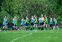 Youth girls post soccer game team handshake,