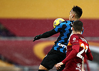 Football, Serie A: AS Roma -  FC Internazionale Milano, Olympic stadium, Rome, January 10, 2021. <br /> Inter's Lautaro Martinez (l) in action with Roma's Gianluca Mancini (r) during the Italian Serie A football match between Roma and Inter at Rome's Olympic stadium, on January 10, 2021.  <br /> UPDATE IMAGES PRESS/Isabella Bonotto