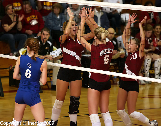 SIOUX FALLS, SD - NOVEMBER 5: Breanna Stewart #8 and Anne Aamlid #6 and Erica Coomes #10 of Roosevelt celebrate a point in front of Liz Kappenman #6 of O'Gorman in the first game of their District 1 Tournament match Thursday evening at Roosevelt. (Photo by Dave Eggen/Inertia).