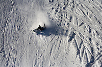 A crashed snowboarder lays on the ground at Showdown Ski Area on King's Hill in the Little Belt Mountains near Neihart, Montana, USA.