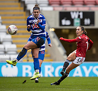 7th February 2021; Leigh Sports Village, Lancashire, England; Women's English Super League, Manchester United Women versus Reading Women; Deanna Cooper of Reading attempts to block a shot by Katie Zelem of Manchester United Women