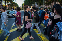 """Armenia. Yerevan. Lilit Martirosyan walks on a pedestrian crossing in the town center. She carries a pink purse on her right arm. She is a transgender woman and a civil rights activist fighting for the rights of trans people in Armenia. On her right arm, a tattoo with the words """" All Equal All Different"""". Lilit Martirosyan is the founder and the president of the NGO called """"Right Side"""", founded in 2016 to defend and fight for the rights of the trans community in Armenia. She became on April 5th 2019 the first member of her country's lesbian, gay, bisexual, transgender and intersex (LGBTI) community to deliver a speech on the parliamentary podium, speaking out against discrimination at a session of its committee on human rights. A trans woman (sometimes trans-woman or transwoman) is a woman who was assigned male at birth. Trans women may experience gender dysphoria and may transition; this process commonly includes hormone replacement therapy and sometimes sex reassignment surgery, which can bring immense relief and even resolve gender dysphoria entirely. Yerevan, sometimes spelled Erevan, is the capital and largest city of Armenia. 1.10.2019 © 2019 Didier Ruef"""