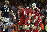 Jake Ball congratulates Rhodri Williams after the Wales replacement scrum half scores.<br /> RBS 6 Nations 2014<br /> Wales v Scotland<br /> Millennium Stadium<br /> <br /> 15.03.14<br /> <br /> ©Steve Pope-SPORTINGWALES