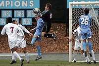 SMU goalkeeper Matt Wideman (0) claims the ball in the penalty area away from UNC's Ben Hunter. Southern Methodist University defeated the University of North Carolina 3-2 in double overtime at Fetzer Field in Chapel Hill, North Carolina, Saturday, December 3, 2005.