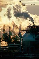 Oil refinery with airplane and smoke Philadelphia PA