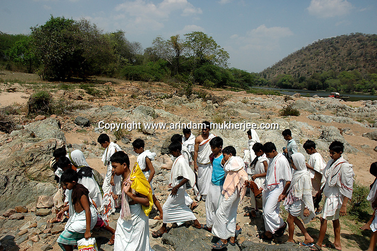 Students of Om Shantidhama coming back from an outing. Om Shantidhama is a residential vedic school for boys. Nestled among the confluence of hills, forest and rivers - Om Shanti Dhama is a world removed from the maddeningly fast and often chaotic urban India. Students from allover the country are selected to take part in its Vedic and free education system. What is unique about this institute is that they have blended the traditional and modern education system. Here computer and science is taught with the same passion as the Vedas and Shastras, helping the students to grow spiritually as well as earn a living. Bonding with the nature and animal world is a mandatory part of the institute's curriculum. Karnataka, India. Arindam Mukherjee