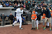 Left fielder Tim Tebow (15) of the Columbia Fireflies takes the field in his first Class A game against the Augusta GreenJackets on Opening Day, Thursday, April 6, 2017, at Spirit Communications Park in Columbia, South Carolina. (Tom Priddy/Four Seam Images)