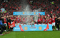 Pictured: Manchester United players and staff celebrate with champagne. Sunday 12 May 2013<br /> Re: Barclay's Premier League, Manchester City FC v Swansea City FC at the Old Trafford Stadium, Manchester.