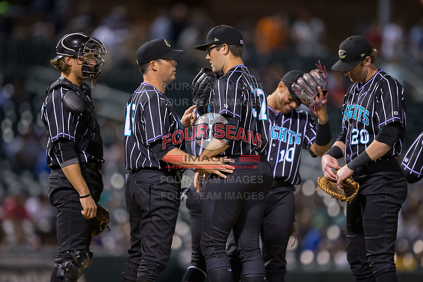 Charlotte Knights manager Mark Grudzielanek (15) gives instructions to relief pitcher Matt Purke (37) during the game against the Norfolk Tides at BB&T BallPark on May 2, 2017 in Charlotte, North Carolina.  The Knights defeated the Tides 8-3.  (Brian Westerholt/Four Seam Images)