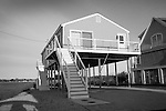 Plum Bank Road, Route 154, Saybrook, CT.  Shorefront house raised on posts.