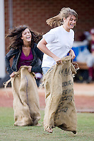 Two fans compete in a potato sack race between innings at Williard Stadium March 14, 2010 in High Point, North Carolina.  Photo by Brian Westerholt / Four Seam Images
