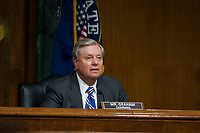 """United States Senator Lindsey Graham (Republican of South  Carolina), Chairman, US Senate Judiciary Committee listens as Professor Russell A. Miller, J.B. Stombock Professor of Law Washington and Lee University School of Law Lexington, VA and Professor ChimËne Keitner, Alfred And Hanna Fromm Professor Of International Law UC Hastings Law San Francisco San Francisco, CA, testify during a US Senate Committee on the Judiciary hearing entitled """"The Foreign Sovereign Immunities Act, Coronavirus, and Addressing China's Culpability"""" in the Dirksen Senate Office Building on Capitol Hill in Washington, DC., Tuesday, June 23, 2020. Credit: Rod Lamkey / CNP<br /> Credit: Rod Lamkey / CNP/AdMedia"""