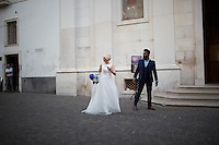 A bride and groom make their way through the streets outside of the Convento di San Francesco on Thursday, Sept. 17, 2015, in Sorrento, Italy. (Photo by James Brosher)
