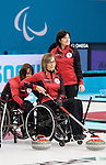 Sochi, RUSSIA - Mar 7 2014 -  Ina Forrest, Sonja Gaudet and Wendy Morgan of Canada's Wheelchair Curling Team trains before the Sochi 2014 Paralympic Winter Games in Sochi, Russia.  (Photo: Matthew Murnaghan/Canadian Paralympic Committee)