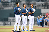 Columbia Fireflies Mark Vientos, Jose Butto and Chase Chambers at the National Anthem before a game against the Charleston RiverDogs on Friday, April 5, 2019, at Segra Park in Columbia, South Carolina. Charleston won, 6-1. (Tom Priddy/Four Seam Images)