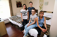 Pictured: Home owner Amanda Hopkins (FRONT) with three of her four children, Morganne, 24 (3rd L) and Rowan 13 (C)(3rd L) in the one bed Ynyscedwyn Arms B&B room that they are staying temporarily in nearby Ystradgynlais. Thursday 31 August 2017<br /> Re: Home owners and tennants have been served to evacuation orders by Neath Port Talbot County Council over fears that a landslip has made their houses unsafe in Cyfyng Road, Ystalyfera, Wales, UK.