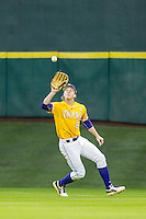 LSU Tigers outfielder Andrew Stevenson (6) makes a catch during the Houston College Classic against the Nebraska Cornhuskers on March 8, 2015 at Minute Maid Park in Houston, Texas. LSU defeated Nebraska 4-2. (Andrew Woolley/Four Seam Images)