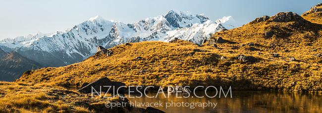 Alpine tarn with Southern Alps and its main highest peaks Aoraki Mount Cook, Mount Tasman and La Perouse, Westland Tai Poutini National Park, UNESCO World Heritage Area, West Coast, New Zealand, NZ