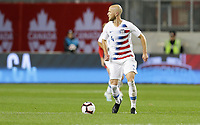TORONTO, ON - OCTOBER 15: Michael Bradley #4 of the United States looks for an open man downfield during a game between Canada and USMNT at BMO Field on October 15, 2019 in Toronto, Canada.