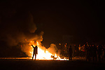 "© Joel Goodman - 07973 332324 . 23/10/2016 . Calais , France . Residents set fires at the Calais migrant camp known as "" The Jungle "" , in Northern France , on the evening before the start of the eviction and destruction of the camp . Photo credit : Joel Goodman"