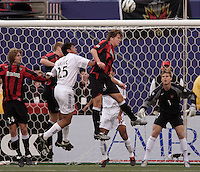 The MetroStars' Eddie Gaven, Tim Regan, and Michael Bradley battle Brian Ching of the EarthQuakes for a header in front of the MetroStars' goal as goalkeeper Zach Wells watches. The San Jose EarthQuakes defeated the MetroStars 1 - 0 at Giant's Stadium, East Rutherford, NJ, on Saturday May 7, 2005.
