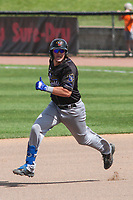 Quad Cities River Bandits first baseman Vinnie Pasquantino (13) rounds the bases during a game against the Wisconsin Timber Rattlers on July 11, 2021 at Neuroscience Group Field at Fox Cities Stadium in Grand Chute, Wisconsin.  (Brad Krause/Four Seam Images)