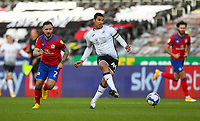 31st October 2020; Liberty Stadium, Swansea, Glamorgan, Wales; English Football League Championship Football, Swansea City versus Blackburn Rovers; Ben Cabango of Swansea City passes the ball while under pressure from Adam Armstrong of Blackburn Rovers