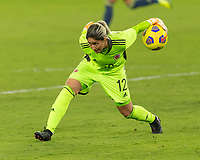 ORLANDO, FL - JANUARY 22: Sandra Sepúlveda #12 rolls the ball to a teammate during a game between Colombia and USWNT at Exploria stadium on January 22, 2021 in Orlando, Florida.