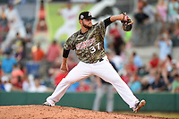 Arkansas Travelers pitcher Cam Bedrosian (37) delivers a pitch during a game against the San Antonio Missions on May 25, 2014 at Dickey-Stephens Park in Little Rock, Arkansas.  Arkansas defeated San Antonio 3-1.  (Mike Janes/Four Seam Images)