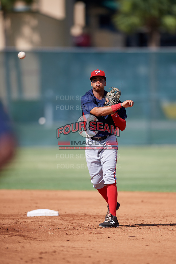 GCL Nationals second baseman Ronaldy Sosa (1) throws to first base during a game against the GCL Cardinals on August 5, 2018 at Roger Dean Chevrolet Stadium in Jupiter, Florida.  GCL Cardinals defeated GCL Nationals 17-7.  (Mike Janes/Four Seam Images)