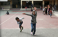Pictured: Migrant girls play in the yard of the Thissio 72nd Primary School of Athens Greece. Monday 10 October 2016<br /> Re: Children of refugees have started school in various parts of Greece.