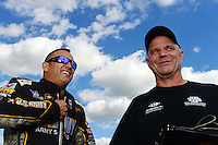 Sept 8, 2012; Clermont, IN, USA: NHRA top fuel dragster driver Tony Schumacher (left) with funny car driver Tim Wilkerson during qualifying for the US Nationals at Lucas Oil Raceway. Mandatory Credit: Mark J. Rebilas-
