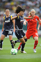 Los Angeles Sol Han Duan (left) runs down the ball against  Washington Freedom Beck Sauerbrunn (22) in the second half at the Home Depot Center in Carson, CA on Sunday, March 29, 2009.