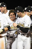 Vanderbilt Commodores outfielder Rhett Wiseman (8) congratulated by Kyle Smith (39) after the game winning hit during a game against the Indiana State Sycamores on February 20, 2015 at Charlotte Sports Park in Port Charlotte, Florida.  Vanderbilt defeated Indiana State 3-2.  (Mike Janes/Four Seam Images)