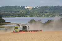 15-8-2021 Harvesting wheat on the edge of Rutland Water.<br /> Tim Scrivener Photographer 07850 303986<br /> …..Covering Agriculture In The Uk…..