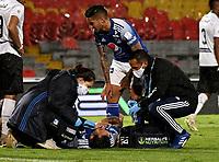 BOGOTA - COLOMBIA, 27-11-2020: Ricardo Marquez de Millonarios F. C. recibe atencion medica, durante partido entre Millonarios F. C. y Once Caldas de la fecha 1 por la Liguilla BetPlay DIMAYOR 2020 jugado en el estadio Nemesio Camacho El Campin de la ciudad de Bogota. / Ricardo Marquez of Millonarios F. C. receives medical attention, during a match between Millonarios F. C. and Once Caldas of the 1st date for the BetPlay DIMAYOR 2020 Liguilla played at the Nemesio Camacho El Campin Stadium in Bogota city. / Photo: VizzorImage / Luis Ramirez / Staff.