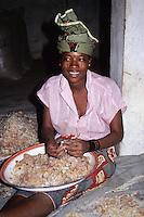 Gum Arabic.  Nigerien Woman Removing Straw and Dirt by Hand.  Niamey, Niger, West Africa.