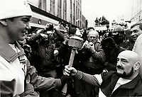 Montreal (Qc) CANADA - Dec 12 1987 File Photo - Mad Dod Vachon (R) get the olympic torch, in background : Montreal Gazette Photographer Len Sidaway