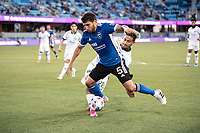 SAN JOSE, CA - MAY 15: Eric Remedi #5 of the San Jose Earthquakes is tackled by Pablo Bonilla #28 of the Portland Timbers during a game between San Jose Earthquakes and Portland Timbers at PayPal Park on May 15, 2021 in San Jose, California.