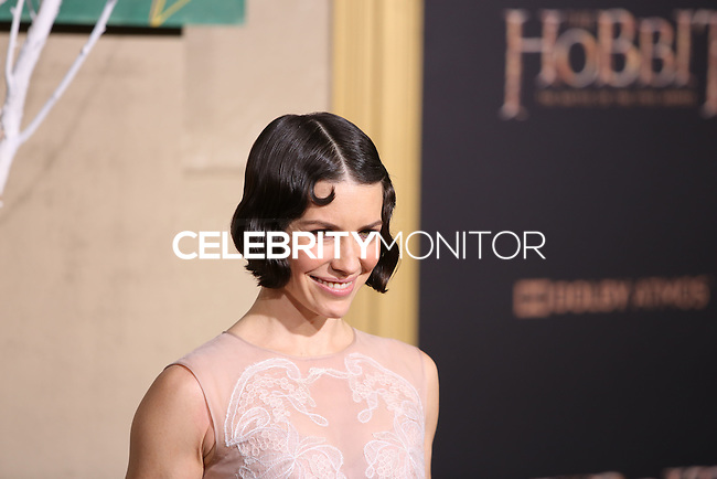 HOLLYWOOD, LOS ANGELES, CA, USA - DECEMBER 09: Evangeline Lilly arrives at the World Premiere Of New Line Cinema, MGM Pictures And Warner Bros. Pictures' 'The Hobbit: The Battle of the Five Armies' held at the Dolby Theatre on December 9, 2014 in Hollywood, Los Angeles, California, United States. (Photo by Xavier Collin/Celebrity Monitor)