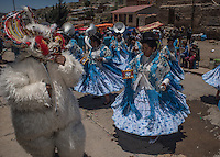 "Dancers accompany the Offertory procession of the Miners Carnival in the descent from the Cerro Rico mountain, for the blessing of their saints in the Cathedral of the city of Potosi, Bolivia. 23 January 2016./ Bailarines acompañan la prosecion del carnaval minero en el descenso del Cerro Rico para la bendicion de los santos en la catedral de la ciudad de Potosi, Bolivia. Enero 23 de 2016. The customs and beliefs of Andean people are a hybrid of catholic religion and old beliefs. One of its highest expressions is within the Bolivian mining culture that worships the Pacha Mama (Mother Earth), the Celestial Divinity personified in the Catholic God and ""El Tio"" of the mine (Satan). To the latter, who rules the underworld, they make offerings with sacrifices of llamas inside the mines to ask for protection in the depths of the mountain and abundant mineral."