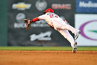 `Second baseman Yoan Moncada (24) of the Greenville Drive snags a line drive in the fifth inning of a game against the Augusta GreenJackets on Thursday, July 16, 2015, at Fluor Field at the West End in Greenville, South Carolina. The Cuban-born 19-year-old Red Sox signee has been ranked the No. 1 international prospect in baseball by Baseball America. Greenville won, 11-5. (Tom Priddy/Four Seam Images)