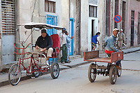 Cuba, Havana.  Three-wheeled Transport.  Bicitaxi Driver Waits for a Customer.
