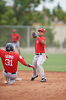 Boston Red Sox second baseman Santiago Espinal (10) throws to first base as Jose Sermo (31) slides in during a minor league Spring Training intrasquad game on March 31, 2017 at JetBlue Park in Fort Myers, Florida. (Mike Janes/Four Seam Images)