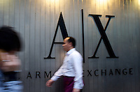 Shoppers from main-land China pass Armani Exchange in Hong Kong.  Main-land Chinese spend fortunes in Hong Kong where luxury goods and most other items are often 15 - 20 percent cheaper than China.
