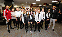 Pictured: Lee Trundle and Jonjo Shelvey pose with pupils Wednesday 25 November 2015<br /> Re: Schools take part in this year's Premier League Enterprise vent at Penderyn Suite, Liberty Stadium, Swansea, UK