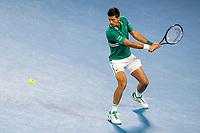 16th February 2021, Melbourne, Victoria, Australia; Novak Djokovic of Serbia returns the ball during the quarterfinals of the 2021 Australian Open on February 16 2021, at Melbourne Park in Melbourne, Australia.